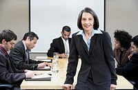 Portrait of businesswoman at business meeting