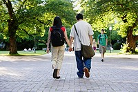 Couple walking outside holding hands