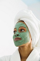 Portrait of woman with beauty mask on face