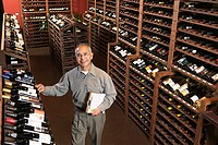Portrait of man in wine cellar