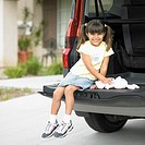 Portrait of girl sitting on tailgate