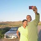 Couple taking picture with camera