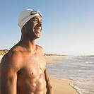 Man in swimming cap at beach