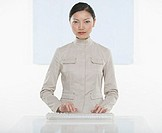 Portrait of businesswoman typing on keyboard