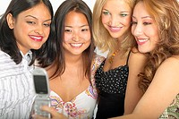 Female friends taking photograph with cell phone (thumbnail)