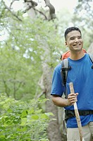 Young man hiking in a forest