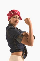 "Young woman dressed as ""Rosie the Riveter"""