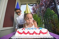 Young boy and girl at birthday party