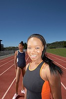 Two female track athletes training outdoors