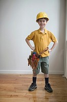 Portrait of boy wearing hard hat and tool belt