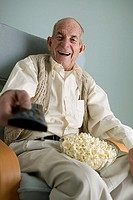 Elderly man watching television