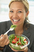 Portrait of businesswoman eating salad