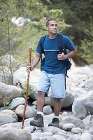 African American man hiking on rocks, Santa Barbara, California, United States,