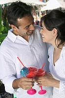 Young couple relaxing with cocktails