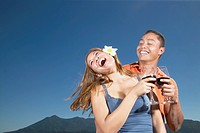 Couple laughing and drinking wine together