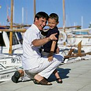 Father with his son on a dock
