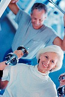 Senior couple exercising in a health club
