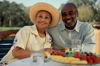 Portrait of a senior couple sitting together smiling