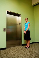 Portrait of a businesswoman standing near an elevator