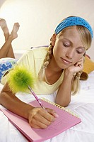 Teenage girl writing in a notebook