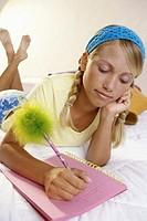Teenage girl writing in a notebook