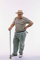 Man standing holding a golf club