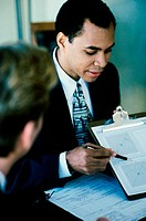 Businessman explaining a document