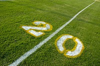Painted yardage lines of football field, some being painted