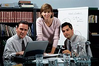 Portrait of two businessmen and a businesswoman in an office