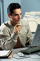 Businessman looking at a computer monitor