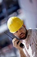 Foreman talking on a walkie-talkie