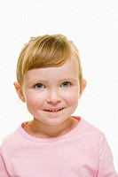 A three year old girl with blonde hair wearing  a pink top and hair pulled back,  looks into camera with a happy expression.
