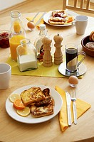 Prepared breakfast on the dining table.