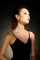 Studio shot of a lady in black dress.