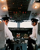 Portrait of Male and Female Pilots Sitting in the Cockpit