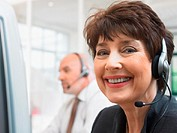 Portrait of a Smiling Businesswoman Wearing a Headset