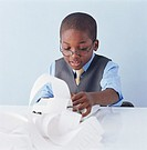 Boy (9-11) wearing suit using adlister