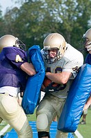 Blocking drills at football practice
