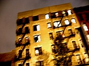 Blurred apartment building in New York's East Village. The image was captured at night, and has a ghostly feel. USA