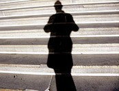 A person's shadow is captured against the marble steps of New York State's Capital building in Albany, New York. Haunting, film noir type feeling. USA...
