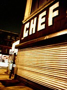 A Closed Restaurant supply store on New York's Lower Eastside is captured at night with a 2 second time exposure.  The resullting photo is an almost p...