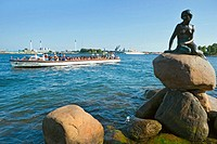 The Little mermaid statue with tour boat, Copenhagen, Denmark