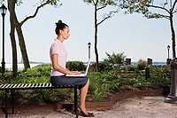 Woman telecommuting in a park