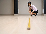 Woman measuring floor
