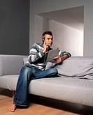 Man with magazine and mobile phone