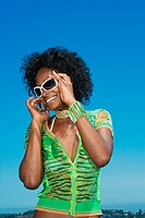 Young woman using a cellular telephone