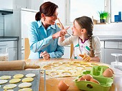 Mother and daughter having fun baking