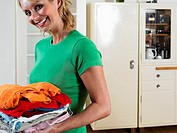 Woman with pile of laundry