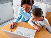 Mother and daughter using laptop computer
