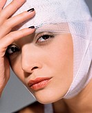 Woman with bandage on her head